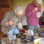 Dr. David Leitner, journeyman cupper, Coffee Analysts taking his first sip
